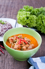 kitchen table with Pork panang curry and rice berry,  hot Sour c