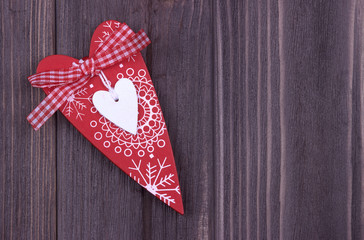 Red Heart on the dark wooden background