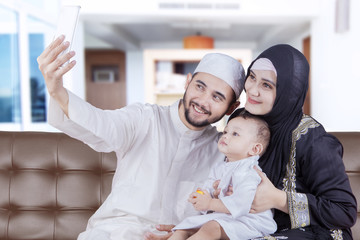 Arabian family taking selfie with smartphone