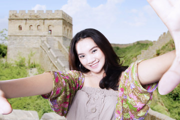 Teenage takes selfie picture at great wall