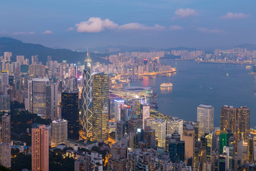Hong Kong central business downtown over Victoria harbor at twilight