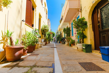 The narrow street of Rethymnon (part of Old Town) where there are a lot of pots with flowers