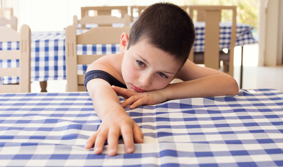 Tired child in restaurant