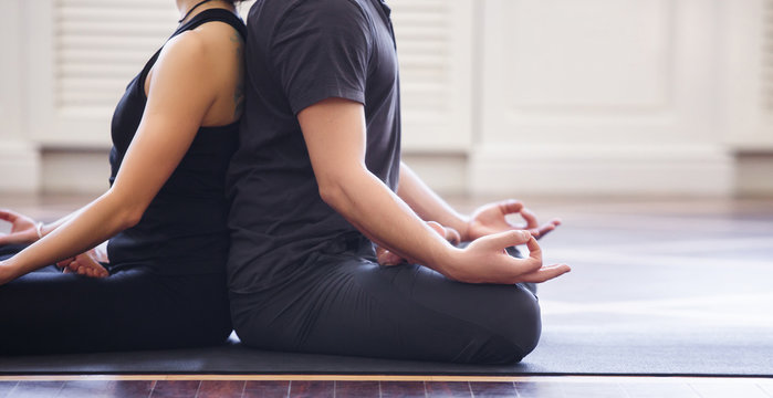 Young couple meditating together