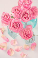 Close-up floral composition with a pink roses.Many beautiful fresh pink roses on a table.