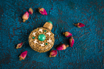 Photo sur Plexiglas Imagination Dry tea rose buds and perfume bottle