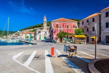 Adriatic place town Pucisca. / View at summer scenery in old Adriatic place Pucisca, Island Brac, croatian travel places.