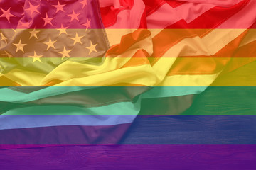 LGBT and USA flags on background
