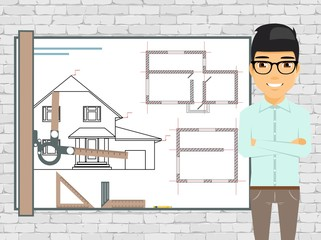 Young man architect working on a project at home. Master of his craft. Building Plans. Drawing board. Brick wall. Confident guy.