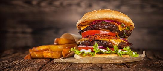 Fototapeta Home made hamburger with lettuce and cheese obraz