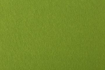 Texture of green felt on macro.