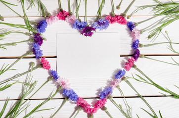 Beautiful cornflowers in shape of heart