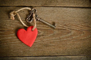 Handmade Heart with key on a wooden board