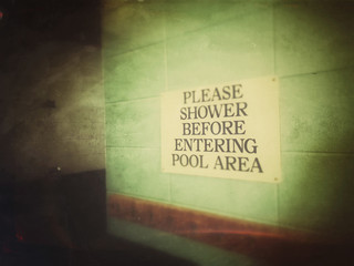 "Sign in locker room ""shower before entering pool area"""