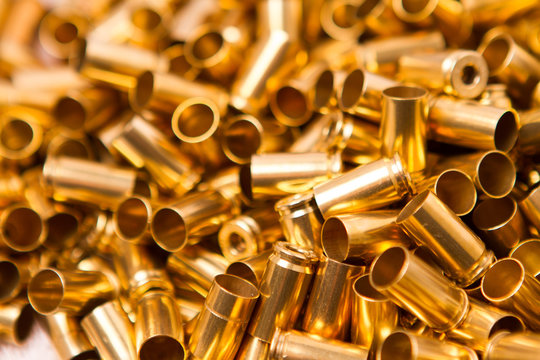 Clean and shiny 9mm brass foreground in focus