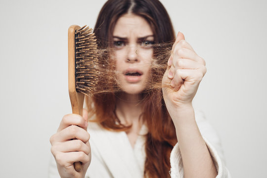 girl with a comb in his hand on a white background distressed hair
