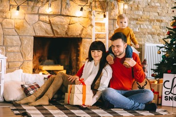 Young family in Christmas interior