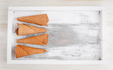 a glass of ice-cream on a wooden background