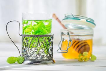 Fresh mint tea with honey in white kitchen