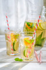 Fresh lemonade with fruits with in old kitchen