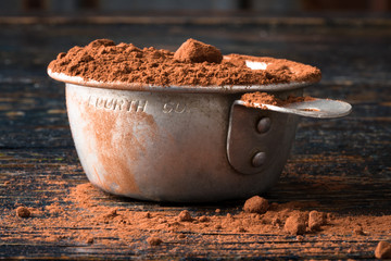 Cocoa Powder in a vintage measuring cup
