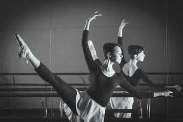 Ballet. Dancer warming up in the hall. Black and white photograp