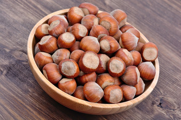 Hazelnuts in a bamboo bowl