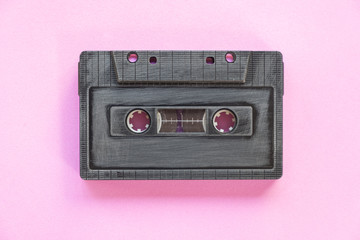 Cassette tape over paper background, top vie