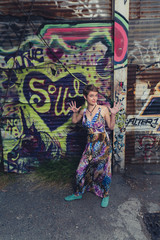 Young Caucasian woman dressed in bohemian style in an urban location