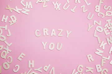 Sorting letters Crazy you on pink.