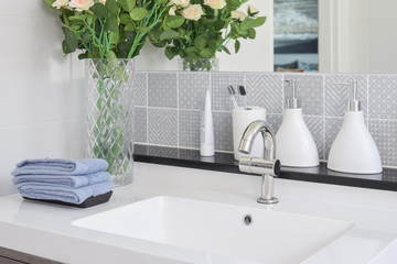 washbasin with faucet and liquid soap bottle at home Fototapete