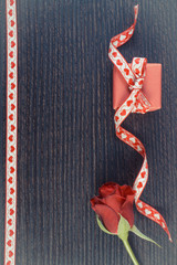 Vintage photo, Wrapped gift with red ribbon and rose for Valentines Day, copy space for text