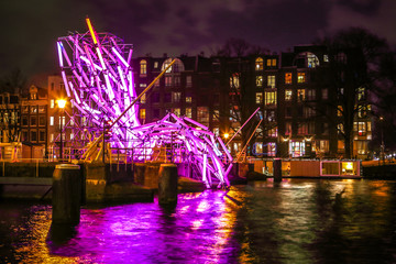 AMSTERDAM, NETHERLANDS - JANUARY 12, 2017: Light installations on night canals of Amsterdam within Light Festival. January 12, 2017 in Amsterdam - Netherland..