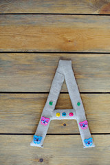 Decorative letter A, wooden background, top view, copy space.