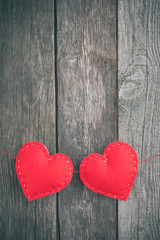 Valentine's day card. Red felt heart placed on vintage wood background and space for your text.