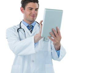 Doctor using a digital tablet against white background