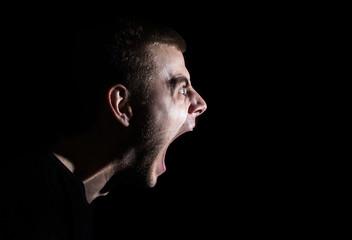 Side portrait of a shouting man, guy, Rage Scream, emotional