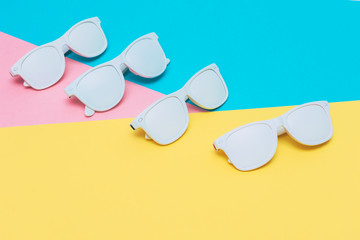 Fashion sunglasses in white color on neon vibrant background. hipster style.