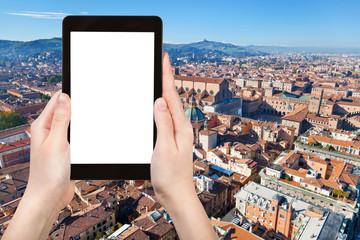 tourist photographs Bologna city on tablet