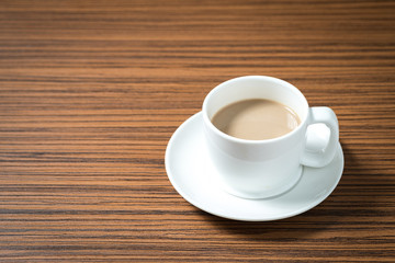 Coffee cup on wooden background.