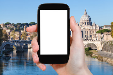 tourist photographs Rome cityscape on smartphone