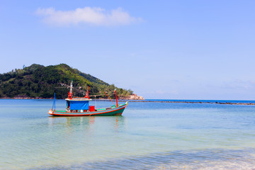 Colorful boat in bay at mountain background