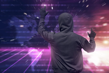Rear view of hooded hacker using virtual screen to hacking