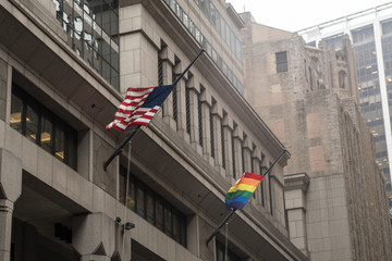 New York, June 28, 2016: American flag and LGBT flag standing side by side in New York City's Financial district