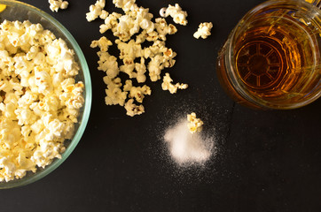 salty popcorn and a mug of beer