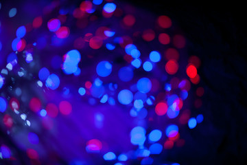 Red and blue bokeh abstract on black background