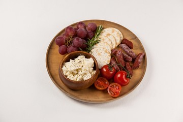 biscuits, cherry tomatoes, grapes, bowl of cheese