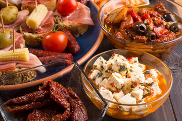 Mediterranean snacks on wooden table - tapas
