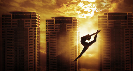 High Rise Building and Sport Woman Dancing Jump, Girl Dancer Silhouette over Apartments House in Sun Light