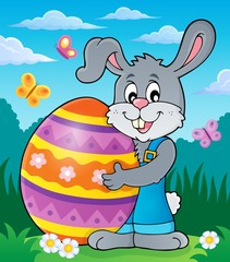 Bunny holding big Easter egg theme 2